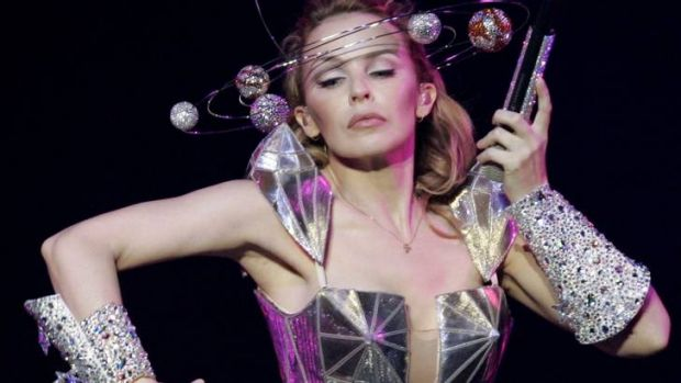 Kylie Minogue plans to give up singing and has split with her manager.