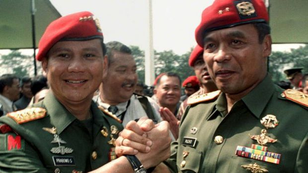 ''Think Putin'' … Prabowo Subianto, left, hands over leadership of Indonesia's special forces in 1998. Prabowo is ...