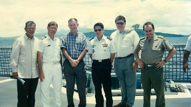 The main players ... Cyril Peel (second from right) with Philippines military personnel in 1997.