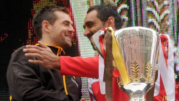 Grand final rivals: Luke Hodge with Adam Goodes yesterday.