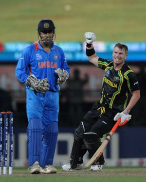 M S Dhoni, captian of India, looks on as David Warner of Australia celebrates after winning the super eight match ...