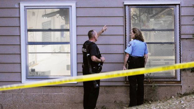 Police investigate the scene of the shooting at Accent Signage Systems in Minneapolis, Minnesota.
