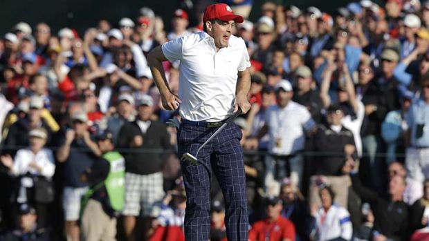 USA's Keegan Bradley reacts after almost making a long eagle putt on the 15th hole at the Medinah Country Club.