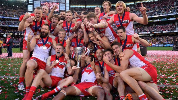 The Swans savour their victory at the MCG.