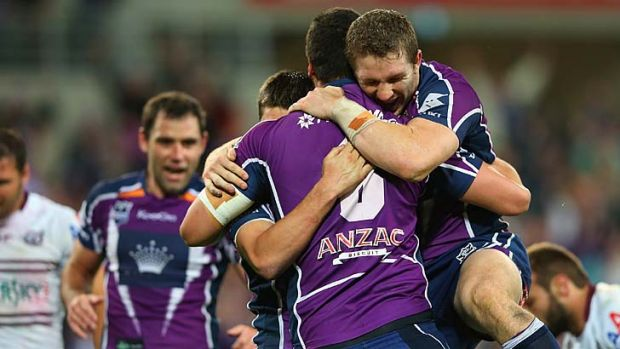Regeneration ... Storm players celebrate last weekend's preliminary final win over Manly.