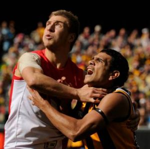 By the throat: Kieren Jack(left) and Cyril Rioli go at it in the hotly contested final.