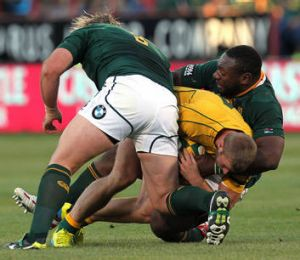 Dom Shipperley is tackled by South Africa's Tendai Mtawarira and Jannie du Plessis
