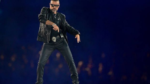 George Michael performs at the Olympic Games closing ceremony.