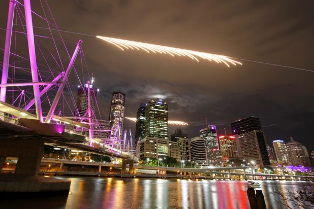 Two Super Hornets fly past the city skyline at the start of Brisbane Riverfire seen from the South Brisbane end of the ...
