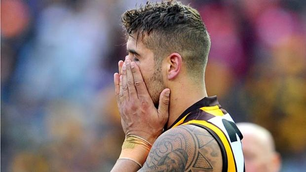 The pain: Lance Franklin finds it hard to face defeat after the final siren.