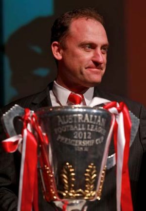 Cup that: Coach John Longmire with the premiership trophy.