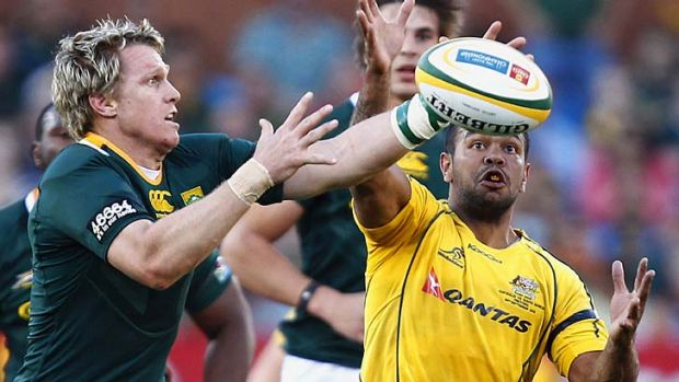 Eyes on the prize … Kurtley Beale competes for the ball with Jean de Villiers.