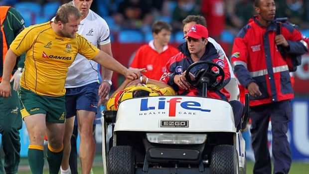 Knocked out ... Benn Robinson consoles Adam Ashley-Cooper after he was badly concussed in a try-saving tackle.