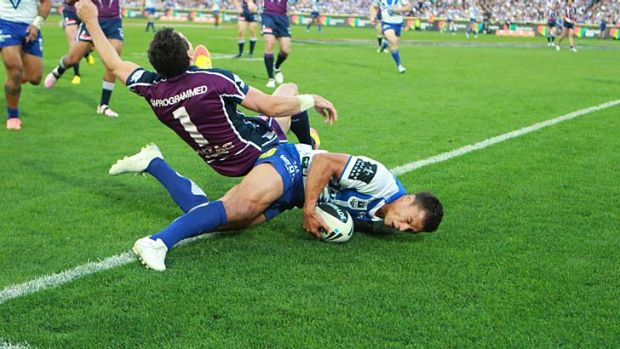 One-off ... Billy Slater flies over Sam Perrett as he scores the Bulldogs' only try of the day. James Graham's alleged ...