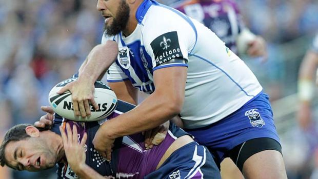 Down ... Sam Kasiano tackles Cameron Smith.