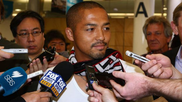 Shinji Ono speaks to the media after his arrival in Sydney.