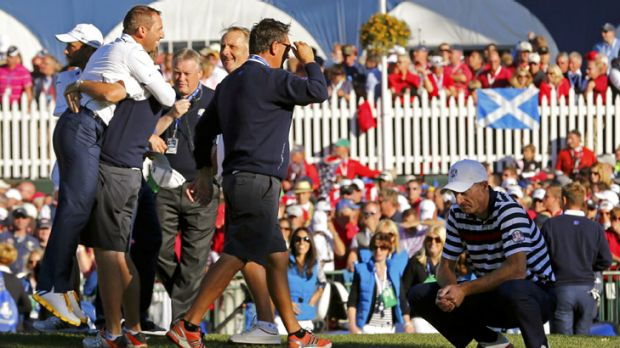 Grand revival ... Dejected US golfer Jim Furyk (right) after losing his match to Europe's Sergio Garcia.