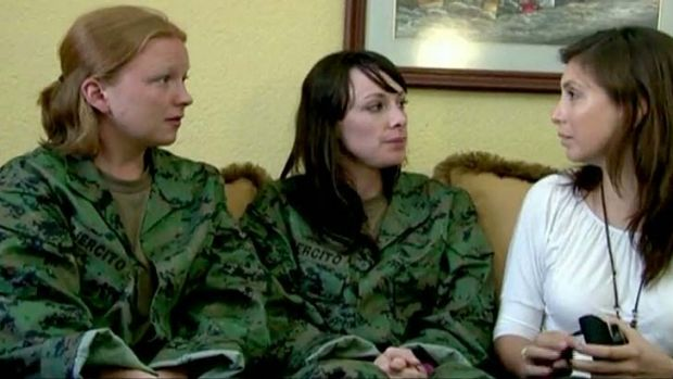 Fiona Wilde, 32, and Kathryn Sara Cox, 23 (left) talk to media after their release.