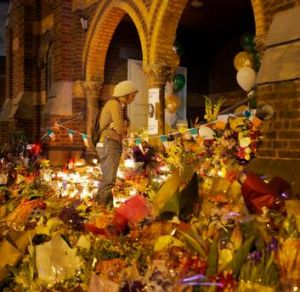 Flowers laid for Jill Meagher at a Sydney Road church.