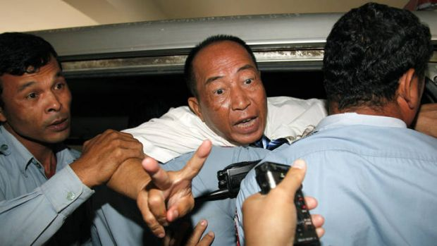 Disturbing pattern ... Mam Sonando, centre,  a prominent critic of Cambodia's government was sentenced to 20 years  jail ...