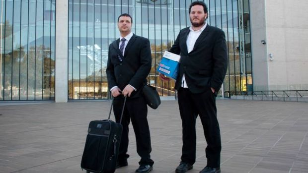 Caleb  (left) and Samuel Courneloup outside the High Court in Canberra. Photo: Andrew Meares