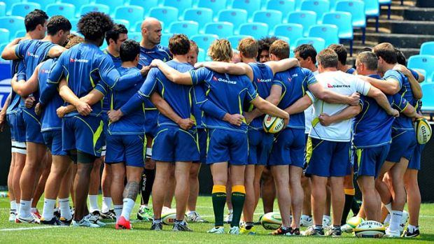 Gee-up … Nathan Sharpe addresses the squad last week before the South Africa match.