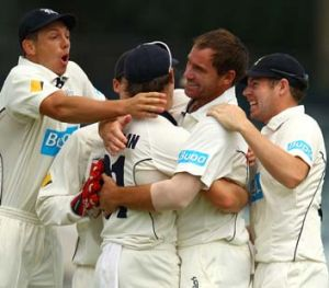 On target: John Hastings is congratulated after taking a wicket for the Bushrangers.