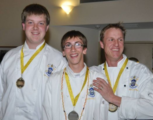 Bradley Bool, Isaac Brown and chef Dean Parkes from St Edmunds College