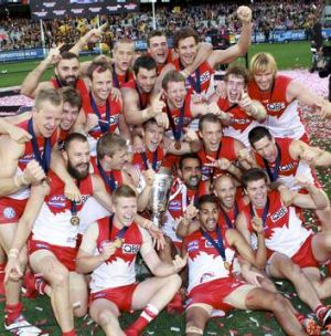 Swans players celebrate after winning the Premiership.