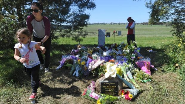 Visitors pay tribute to Jill Meagher at a memorial site where her body was found in Gisborne South.