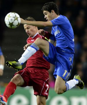 Chelsea's Oscar (right) and Nicolai Stokholm from FC Nordsjalland vie for the ball in their Champions League match in ...