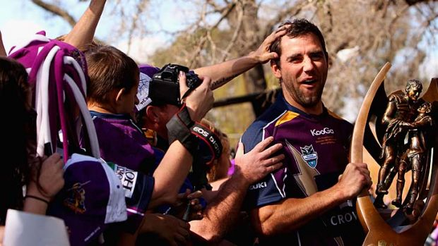 Smiling for the cameras ... Melbourne players, including captain Cameron Smith, met with supporters at a small civic ...