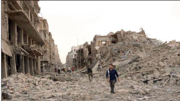 Devastation in Aleppo ... Men walk on a road amid wreckage, after blasts ripped through Aleppo's main Saadallah ...