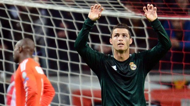 Real Madrid forward Cristiano Ronaldo reacts after scoring a goal against Ajax.