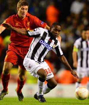 Liverpool midfielder Steven Gerrard (left) in action against Udinese midfielder Willians during their UEFA Europa League ...