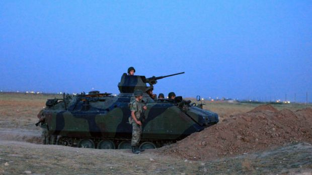 Border patrol … Turkish soldiers stand guard in Akcakale by the Turkish-Syria border, where five people were ...
