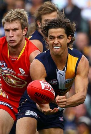 Tom Swift fires off a handball against the Suns last year.
