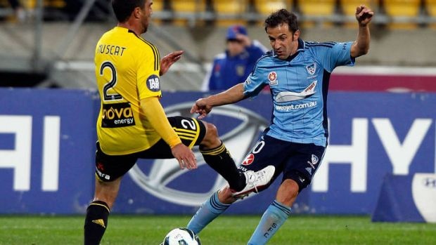 Sydney's Alessandro Del Piero is tackled by Phoenix's Manny Muscat.