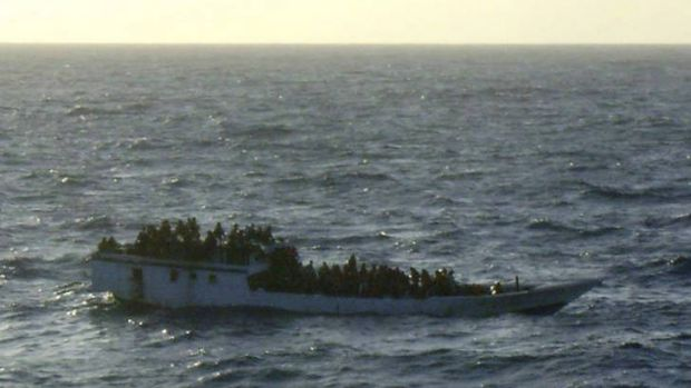A packed asylum-seeker boat in distress earlier this year.