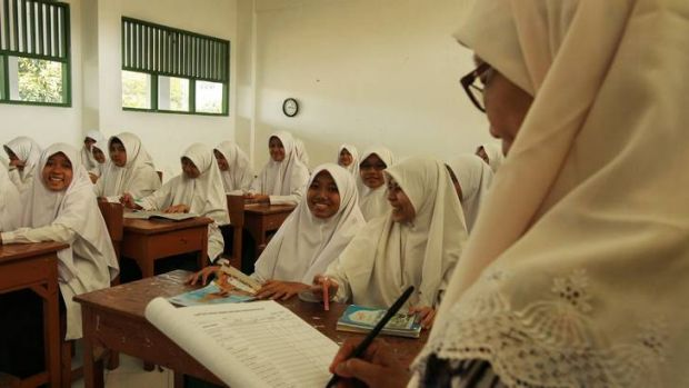 A teacher takes a class of female students at the Al Mukmin school founded by Indonesian radical Cleric Abu Bakar Bashir.