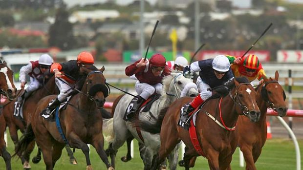 Into space: Jockey Craig Williams punches out Green Moon to win the Turnbull Stakes at Flemington yesterday.