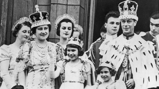 Family first ... Queen and daughters on the balcony at Buckingham Palace with King George VI after his coronation in 1937.