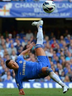 Chelsea's John Terry jumps for the ball.