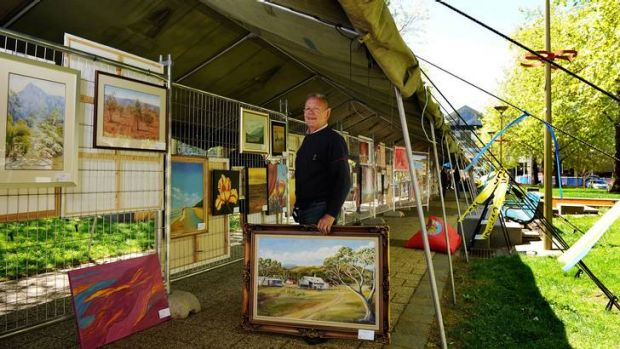 Art show organiser Barry Cranston inside the City Walk tent which was provided by Defence.