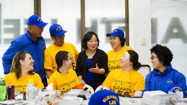 Elizabeth Lee prepares election material with her team at her office in the city. Back, from left: David Lee, John Lee ...