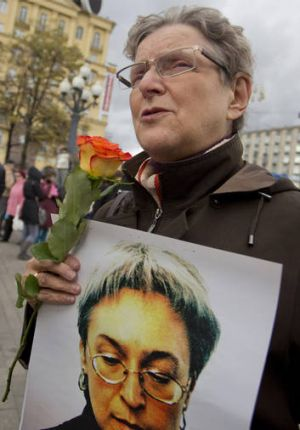 Remembrance ... The founder of the Russian rights group Memorial, Svetlana Gannushkina, holds a portrait of Anna ...