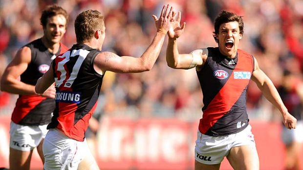 Angus Monfries celebrates an Essendon early in the 2011 Elimination Final.
