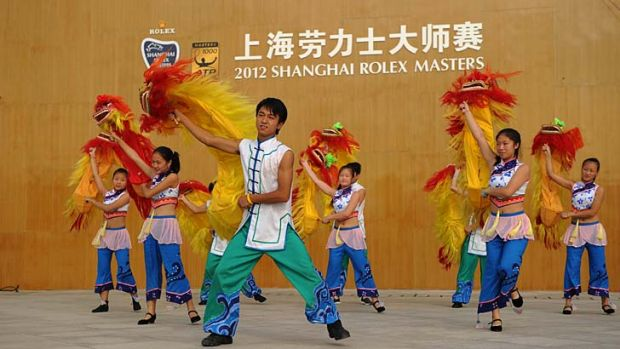 Dancers get ready for a performance at the Shanghai Masters tournament yesterday.