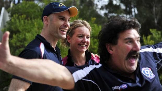 Robert ?Dipper? DiPierdomenico, right, plays up during a photo with former AFL player Tom Harley and Victorian Nationals ...