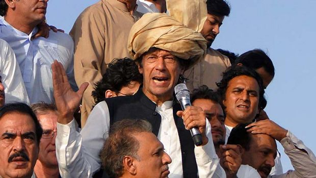 Latest test ... Imran Khan addresses supporters at the march.